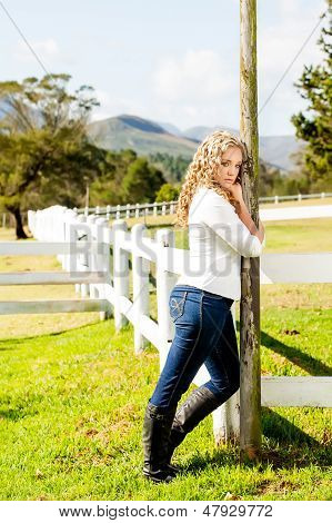 Cowgirl At The Picket Fence