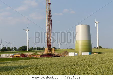 Wind Turbine Under Construction Close To A Wheat Field