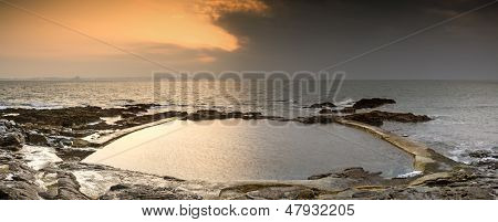 Sunrise at an ocean swimming pool in Spring on England's Cornwall coast