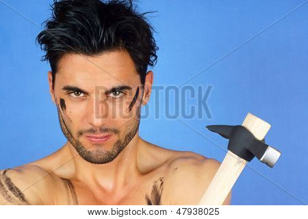 Dirty Manual Worker With Hammer