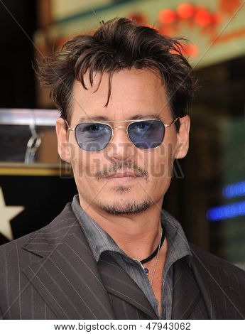 LOS ANGELES - JUN 23:  Johnny Depp arrives to the Walk of Fame Honors Jerry Bruckheimer  on June 23, 2013 in Hollywood, CA