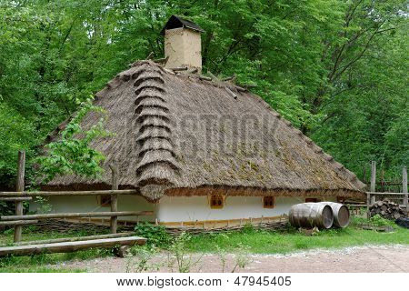 Traditional farmer's house under the thatch roof in open air museum Kiev Ukraine