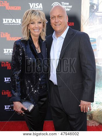 LOS ANGELES - JUN 22:  Cal Ripkin Jr. & wife Kelly arrives to the 'The Lone Ranger' Hollywood Premiere  on June 22, 2013 in Hollywood, CA