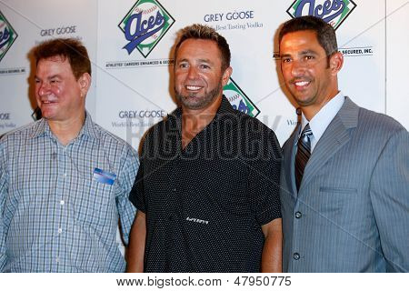 NEW YORK-JULY 14: MLB Network analyst Kevin Millar (left) and former New York Yankees catcher Jorge Posada attend the Aces, Inc. All Star party at Marquee on July 14, 2013 in New York City.