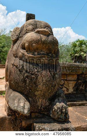 Ancient Lion Guard Near Entrance