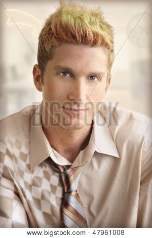 Conceptual stylized fashion portrait of a young edgy trendy man in tie