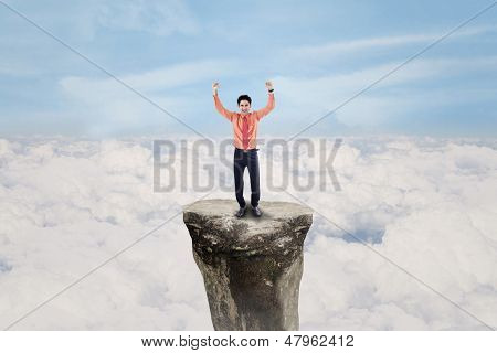 Businessman Exulting Above Cloud Outdoor