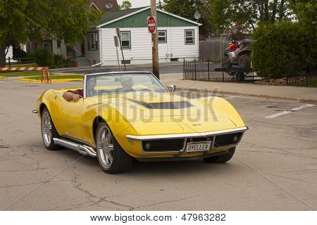 Yellow 1968 Chevy Corvette Roadster Driving