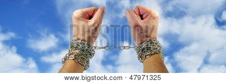 Hands With Chains  On Sky Backgroun