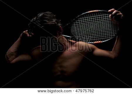 Tennis Player and his Racket with Face Shadowed