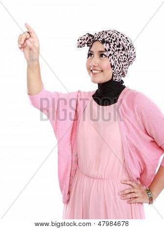 Woman In Head Scraf Touching Imaginary Screen With Her Finger