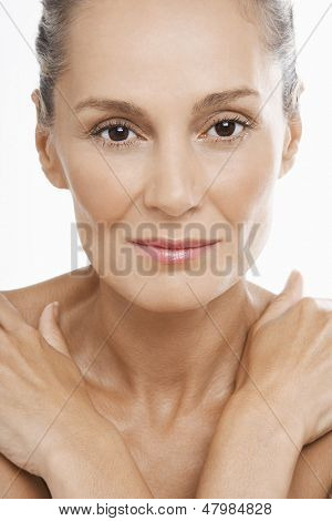 Closeup portrait of beautiful middle aged woman on white background