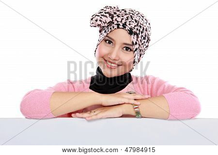 Attractive Woman In Head Scraf Holding Blank White Board