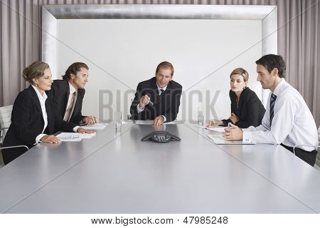 Group of business people on conference call in boardroom