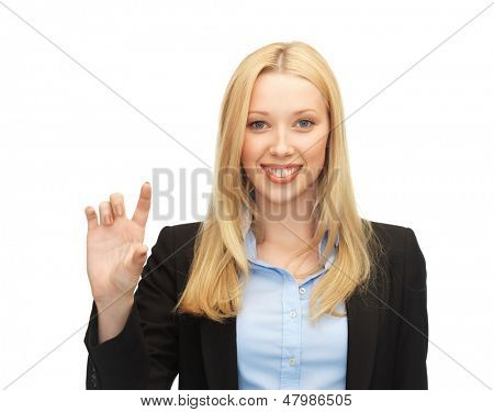 picture of beautiful young businesswoman holding something imaginary