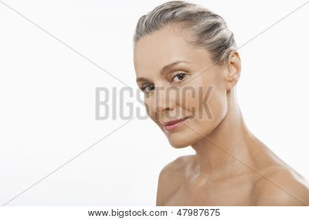 Portrait of confident middle aged woman isolated on white background