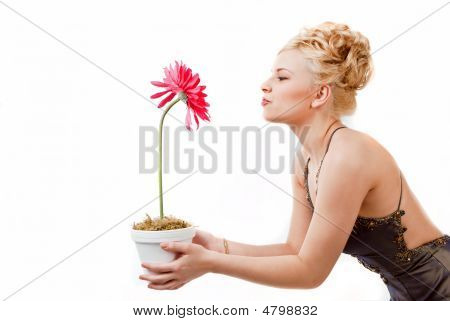 Model Having Fun With A Pink Flower