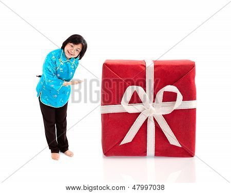 Smiling Chinese  Woman Offering Huge Gift