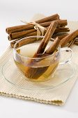 stock photo of naturopathy  - Cinnamon Herbal Tea in a glass cup - JPG