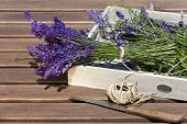stock photo of picking tray  - Freshly picked lavender with thread tied on a wooden tray - JPG