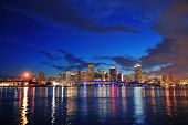 foto of skyscrapers  - Miami city skyline panorama at dusk with urban skyscrapers and bridge over sea with reflection - JPG