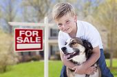 stock photo of yard sale  - Happy Young Boy and His Dog in Front of For Sale Real Estate Sign and House - JPG