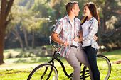 stock photo of adolescent  - lovely happy teenage couple hugging outdoors - JPG