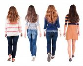 image of backside  - Back view of walking group of woman - JPG