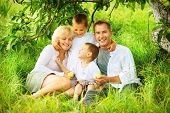 stock photo of orchard  - Happy Big Family Outdoors Having Fun - JPG