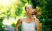 Running woman. Female Runner Jogging during Outdoor Workout in a Park. Beautiful fit Girl. Fitness m