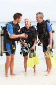 picture of watersports  - Senior Couple Having Scuba Diving Lesson With Instructor - JPG