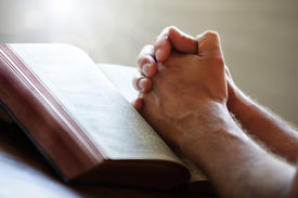 picture of prayer  - Hands folded in prayer on a Holy Bible in church concept for faith - JPG