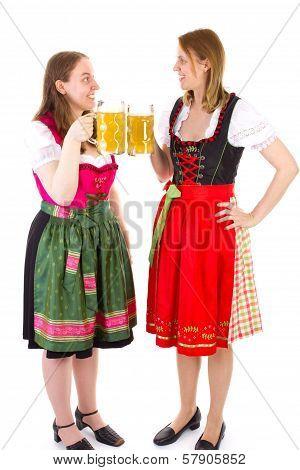 Women In Dirndls Clinking Their Beersteins