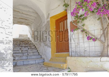 alley and bougainvillea flower in a Mediterranean island