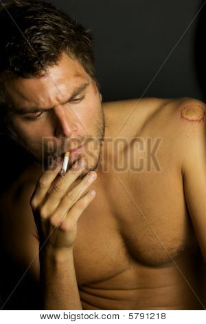 Young Sexy Man Smoking A Cigarette