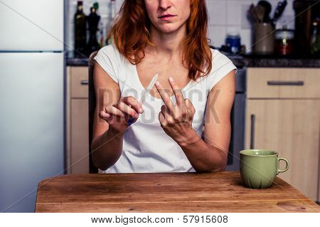 Woman Displays Obscene Gesture