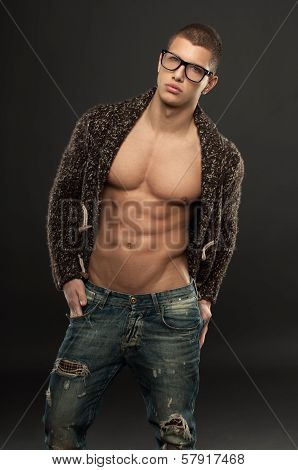 Handsome Athletic Young Man Posing In The Unbuttoned Sweater