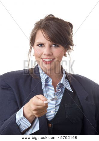 Young business woman handing viewer a business card; isolated