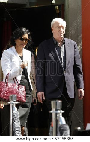 Michael Caine and wife Shakira Caine at the Christopher Nolan Hand and Footprint Ceremony, Chinese Theater, Hollywood, CA 07-07-12