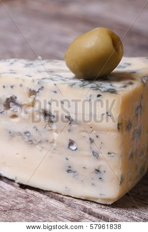 Blue Cheese And Olive On An Old Wooden Table. Vertical.