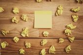 stock photo of memory stick  - Sticky note on wooden desk look from above - JPG
