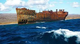 foto of scrappy  - A rusted ship off the coastline of the Hawaiian Islands - JPG