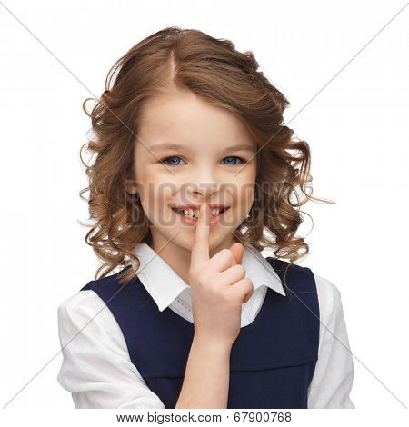 happy children and gestures concept - picture of beautiful pre-teen girl showing hush gesture