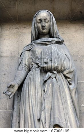 PARIS, FRANCE - NOV 09, 2012: Saint Elizabeth, architectural details of Eglise de la Madeleine. Madeleine Church was designed in its present form as a temple to the glory of Napoleon's army.