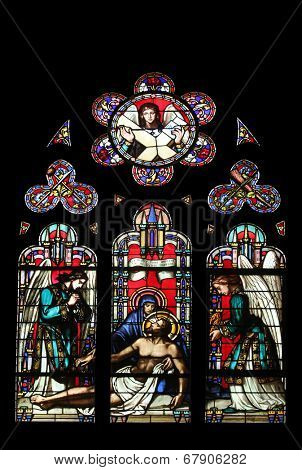 PARIS, FRANCE - NOV 11, 2012: Pieta, stained glass from Church of St-Germain-l'Auxerrois founded in the 7th century, was rebuilt many times over several centuries.
