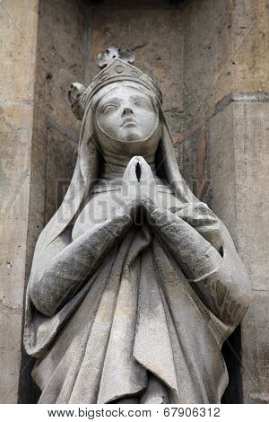 PARIS, FRANCE - NOV 11, 2012: Saint Radegund statue, Church of St-Germain-l'Auxerrois founded in the 7th century, was rebuilt many times over several centuries.