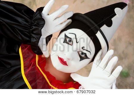 Female mime artist in pierrot clown disguise