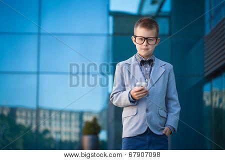 kid businessman on the blue modern background