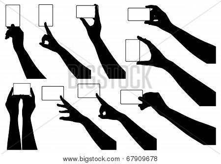 Hands holding business cards