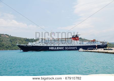 SKIATHOS, GREECE - JUNE 14, 2013: Hellenic Seaways ferry Express Pegasus prepares to dock at Skiathos Town harbour on the Greek island of Skiathos. The 125.7mtr ship was built in Italy in 1977.